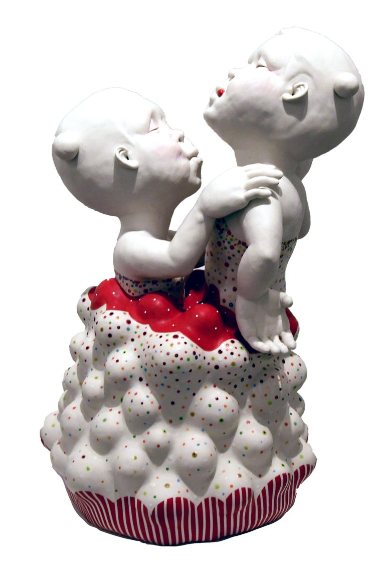 Kyungmin Park is a figurative ceramic sculptor drawing inspiration from childlike perspectives. Contrasting the darker emotions and restricted psyche of adulthood with the boundless consciousness of children, Kyungmin's sculptures confront the view