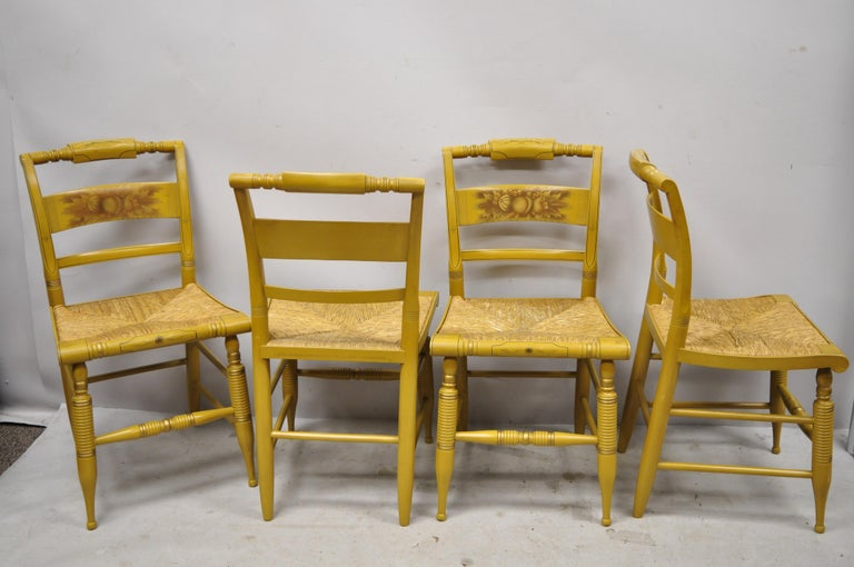 L. Hitchcock yellow stenciled rush seat dining side chairs - Set of 4. Item features yellow stencil painted details, woven rush cord seat, solid wood construction, original signature, very nice vintage item, quality American craftsmanship, circa mid