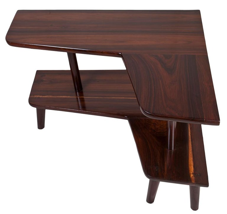 An L-shaped rosewood corner table with lower shelf and tapered legs. 12