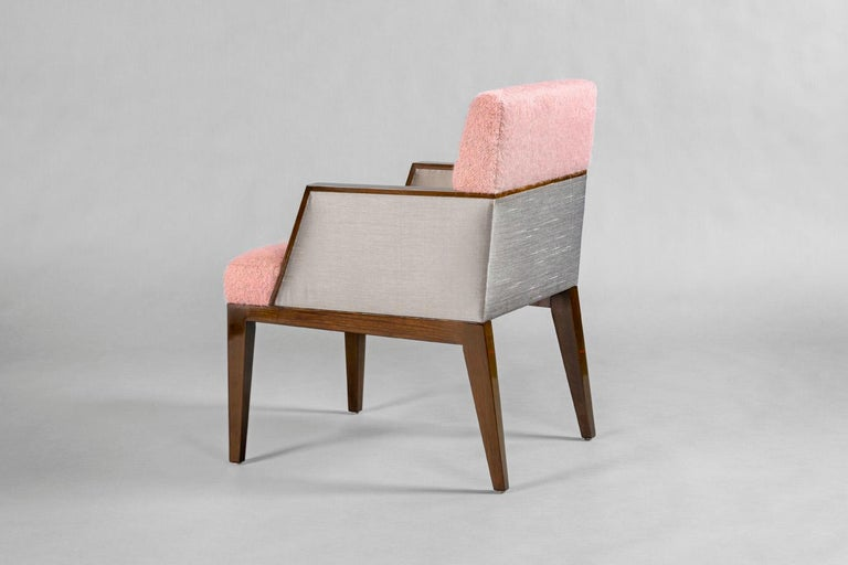 High gloss finished walnut armchair with the back and seat upholstered in pink mohair, the sides in gray silk. 