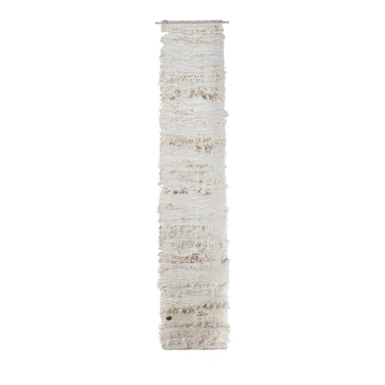 This fascinating handwoven vertical tapestry uses traditional techniques in a composition of linen, hemp, silk, shantung silk, wool and cotton. Seeking to represent a dialogue on The Home, the tapestry is best hung at a distance of 7 - 10 cm from