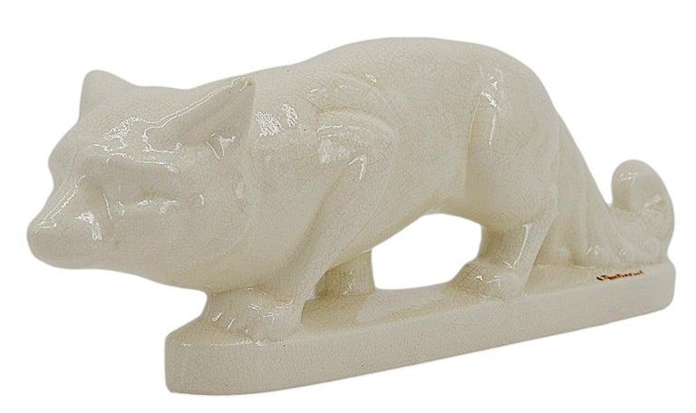 French Art Deco crackle glaze ceramic fox by Jean de la Fontinelle, France, ca.1925. Rare piece by Jean de la Fontinelle. Was sold in Les Magasins du Louvre in Paris. Measures: Width: 15