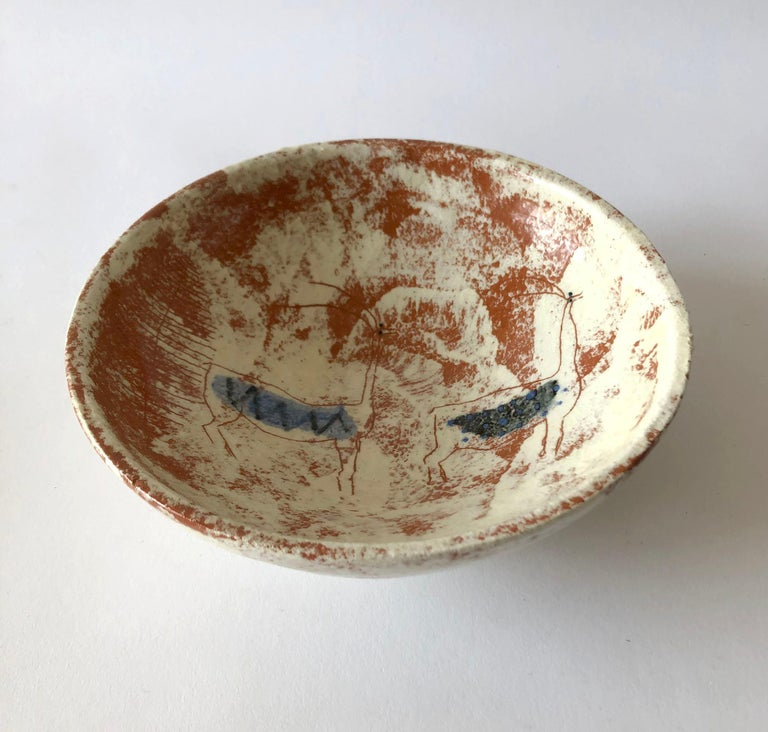Studio ceramic bowl with carved, cave-like design created by La Gardo Tackett. Bowl measures 2.5