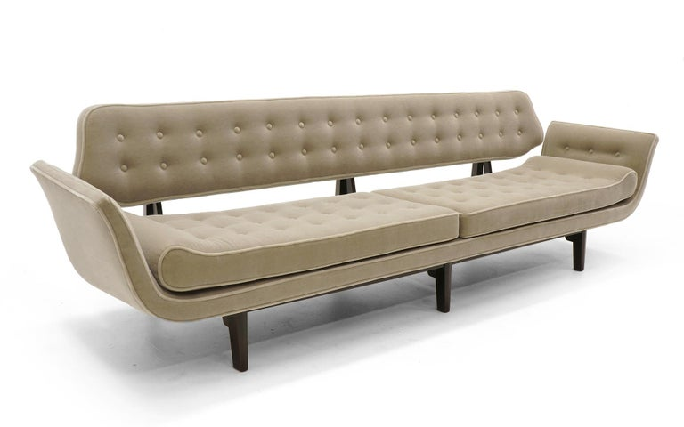Edward Wormley's famous La Gondola sofa. One of the best sofa designs of the entire modern design movement. Expertly refinished and reupholstered in a light to medium grey mohair. Plush and elegant.