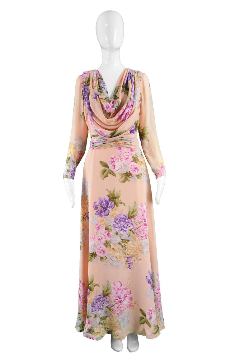 A breathtakingly beautiful vintage maxi dress from the early 70s by legendary Italian luxury fashion label, La Mendola. La Mendola was founded by Mike la Mendola and Jack Savage, designing beautiful dresses for the likes of Rita Hayworth and