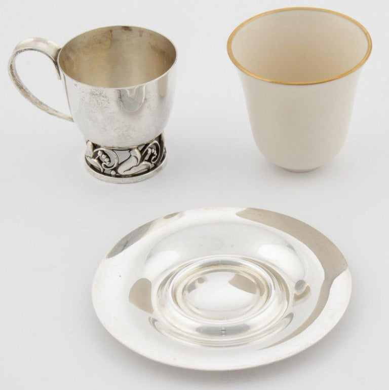 American sterling silver coffee/tea demitasse set designed by Alphonse La Paglia (1907-1953), a Sicilian-born silversmith who studied and trained with Georg Jensen, and retailed by International Sterling. Georg Jensen, a Danish silversmith, set up