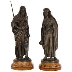 'La Porteuse' and 'Le Guerrier Arabe', Two Patinated Bronze Figures by Salmson