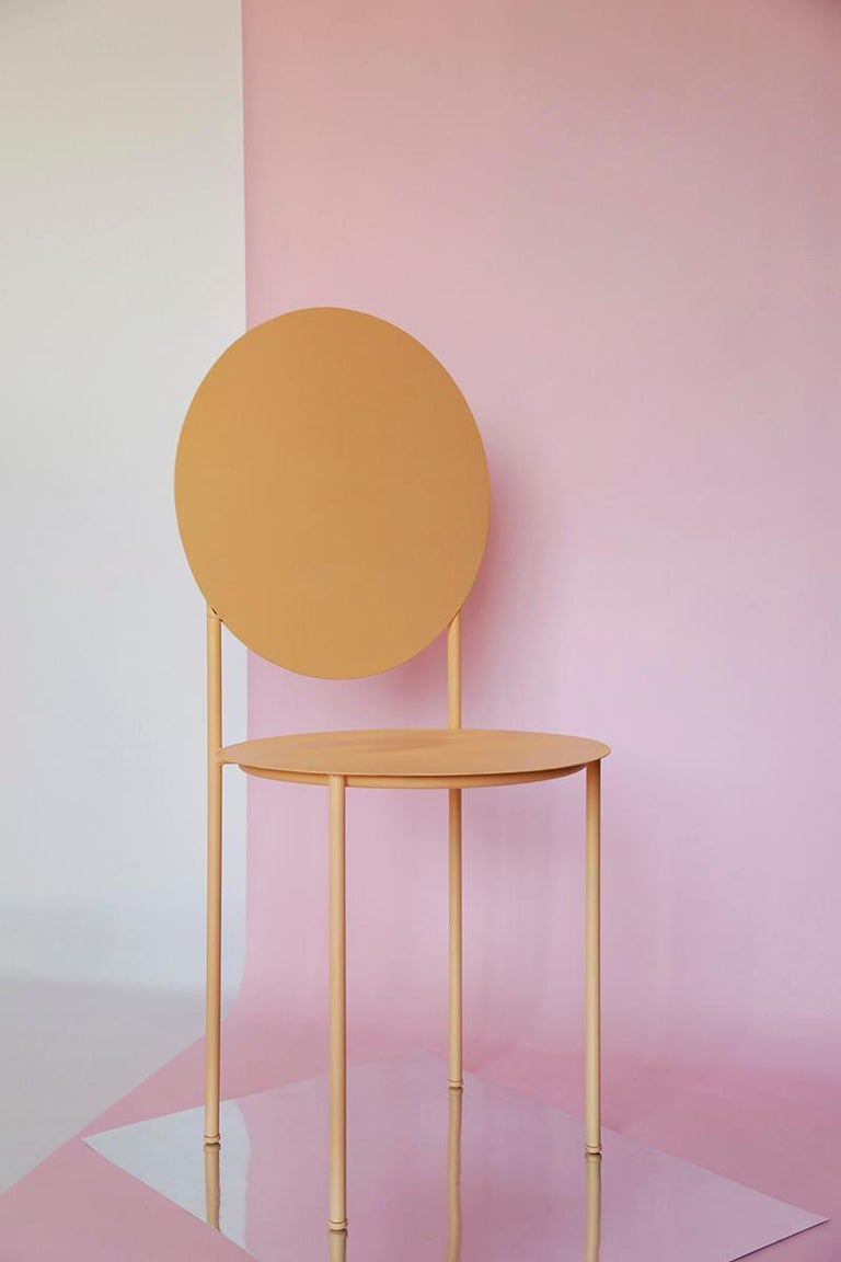 La Prima is built from two circles that turn into the seat and back of a chair; a tubular structure generates the rest of lines, unifying the set. La Prima, designed by the Barcelona design studio Bodegon cabinet, is made from lacquered steel.