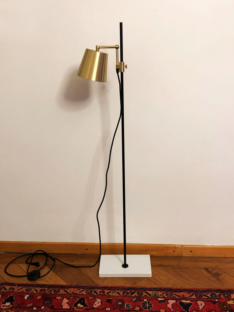 Porcelain base with steel stem and brass aluminum shade. Designed in 2009 by Andrea Kleinloog from Anatomy Design, the Karakter Copenhagen lab floor lamp was inspired by the designer's parents' pharmaceutical work and old lab equipment, giving the