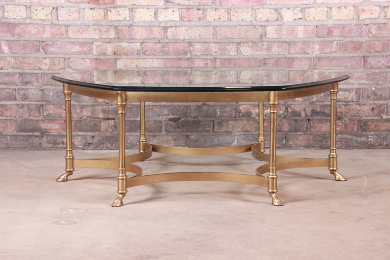 A gorgeous Mid-Century Modern Hollywood Regency hexagonal hooved feet coffee or cocktail table  By Labarge  circa 1960s  Solid brass frame, with beveled glass top.  Measures: 42.38