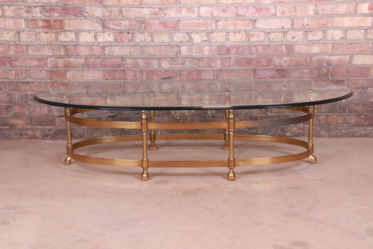 A gorgeous Mid-Century Modern Hollywood Regency oval coffee or cocktail table