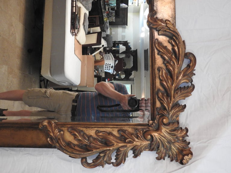 Offering this large Labarge mirror in the style of Rococo. Large mirror with a gilded frame and foliate detail on all four corners. Scales beautifully for a mantel or over a large chest.