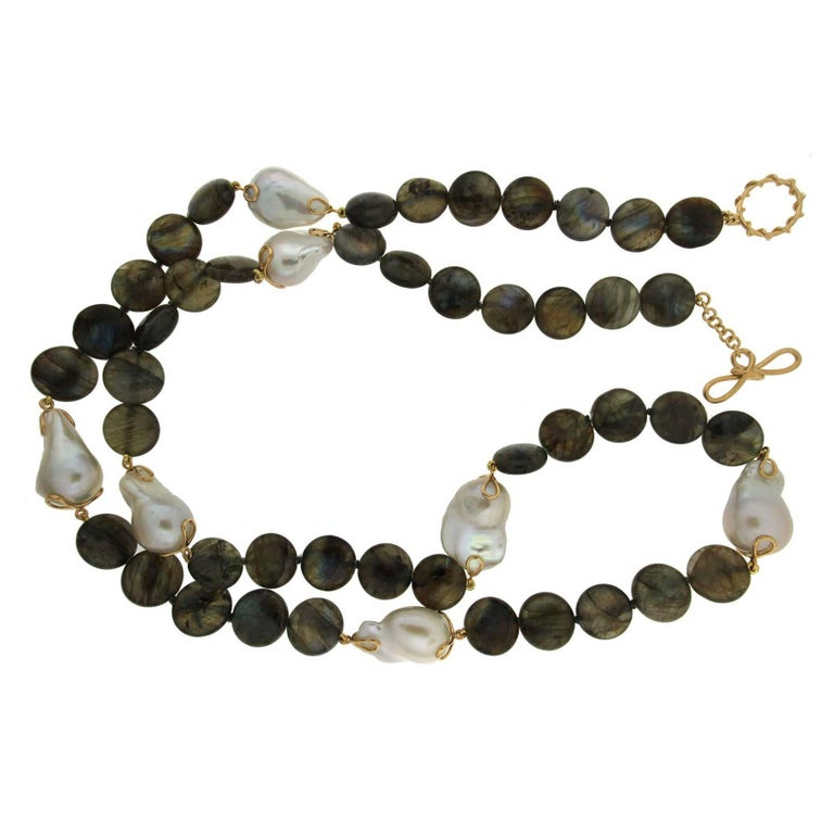 This one of a kind necklace features 16mm Labradorite disks with 7 fresh water pearls and 18kt yellow gold toggle and knot clasp.