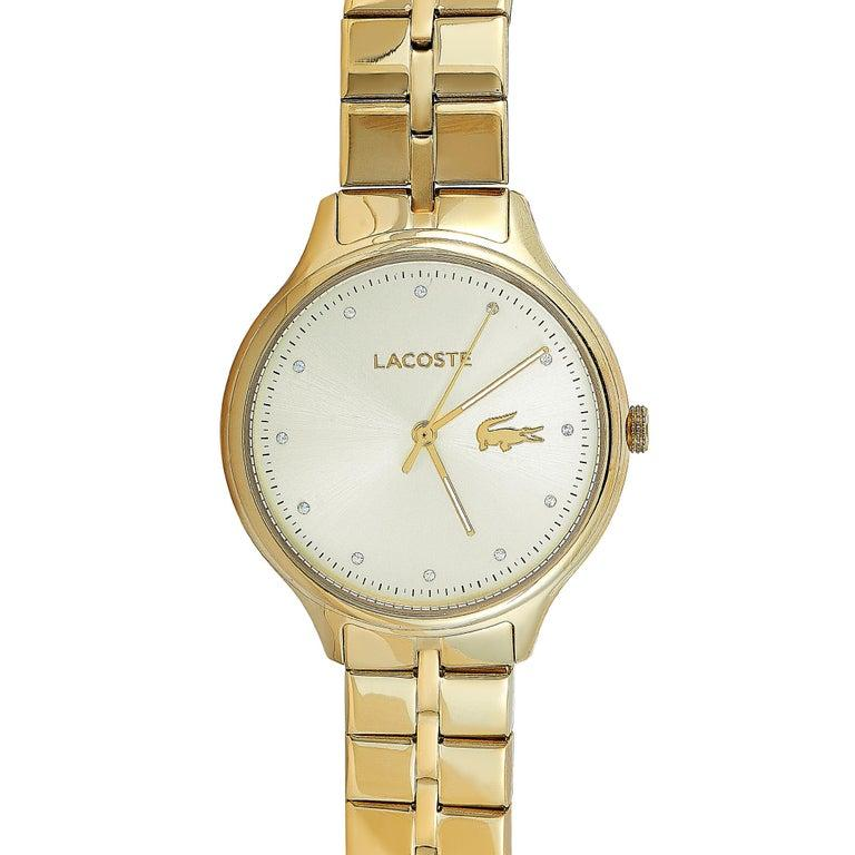 This is the Lacoste Constance watch, reference number 2001008. It is presented with a gold-tone stainless steel case that measures 38 mm in diameter. The case is water-resistant to 30 meters and mounted onto a matching gold-tone stainless steel