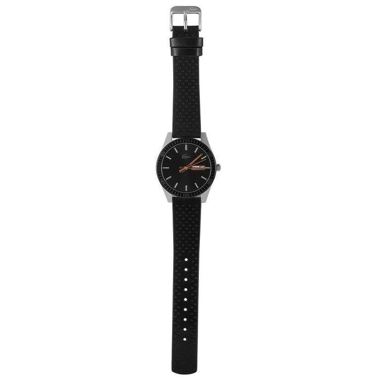 This is the Lacoste Legacy watch, reference number 2010982. It boasts a 42 mm stainless steel case that is presented on a black leather strap, secured on the wrist with a tang buckle. The case is water-resistant to 50 meters. The black dial features