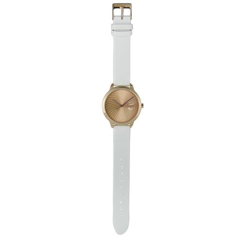 This is the Lacoste Lexi watch, reference number 2001068. It boasts a 38 mm stainless steel case that is presented on a white leather strap, secured on the wrist with a tang buckle. The case is water-resistant to 30 meters. The watch is powered by a