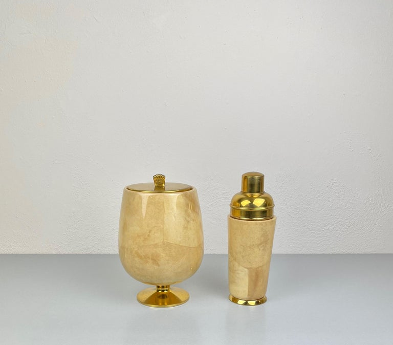 Set of ice bucket and shaker in lacquered beige goatskin and brass by Aldo Tura for Macabo, Italy, 1950s. 
