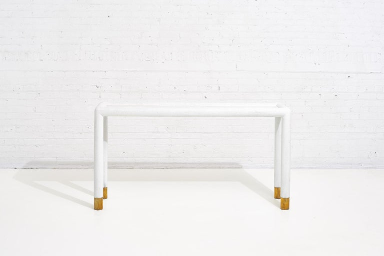 Lacquered grasscloth and brass console table, 1970's. In the style of Karl Springer.