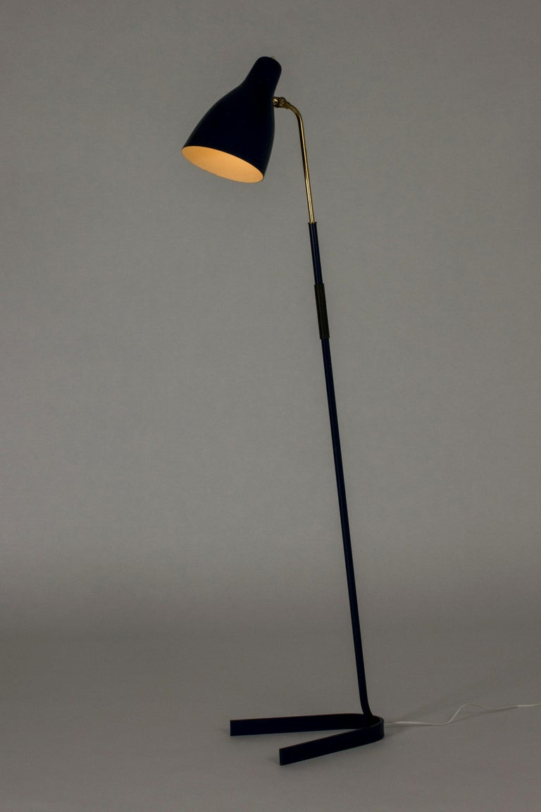 Cool floor lamp from Boréns, made from blue lacquered metal with a distinct U-shaped base.