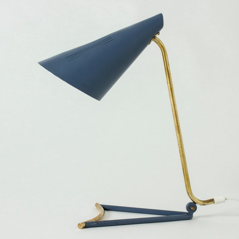 Very cool lacquered metal table lamp by Knud Joos, with an elegantly skewed, open base. The muted blue contrasts nicely with the brass details.