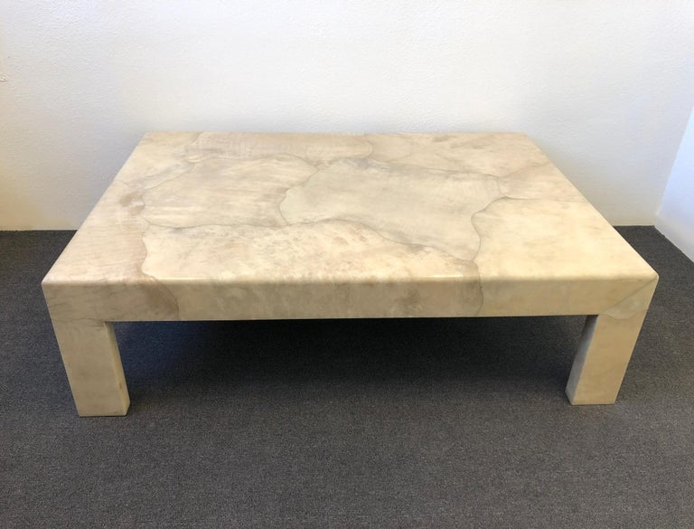 """Large satin lacquered goatskin cocktail table, designed by Sally Sirkin Lewis for J. Robert Scott in the 1980s. The table is in great condition with minor wear consistent with age.  Measurements: 42"""" deep, 60"""" wide and 18"""" high."""