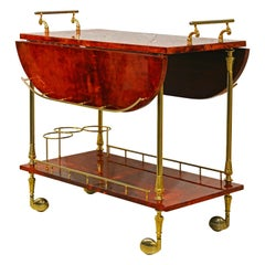 Lacquered Red Goatskin Parchment and Brass Drop Leaf Bar Trolley by Aldo Tura