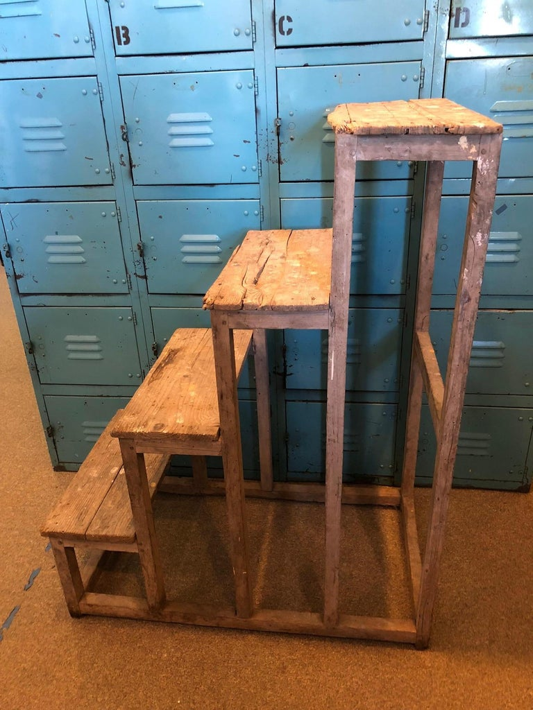 Primitive French ladder with hints of modern sculptural design via a series of rectangles. Pegged nails. Well-worn farm-style wood. Individual steps measures 9