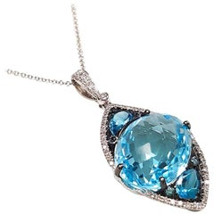 Ladies 14 Karat White Gold Blue Topaz and Diamond Pendant