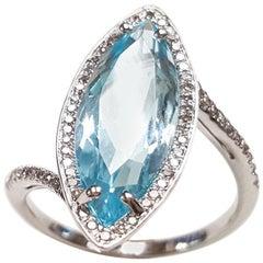 Ladies 14 Karat White Gold Marquise Blue Topaz and Diamond Ring