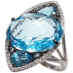 Ladies 14 Karat White Gold Oval Blue Topaz and Diamond Ring