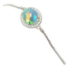 Ladies 14 Karat White Gold Oval Opal and Diamond Rolo Bracelet