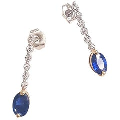 Ladies 14 Karat White Gold Oval Sapphire and Round Diamond Earring
