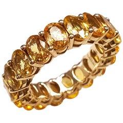 Ladies 14 Karat White Gold Oval Yellow Sapphire Eternity Band