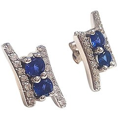 Ladies 14 Karat White Gold Round Sapphire and Round Diamond Earring