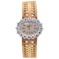 Ladies 18 Karat Yellow Gold Omega Diamond Bezel Dress Watch