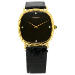 Ladies 18k gold and black dial Longines wristwatch, set with diamond hour marker