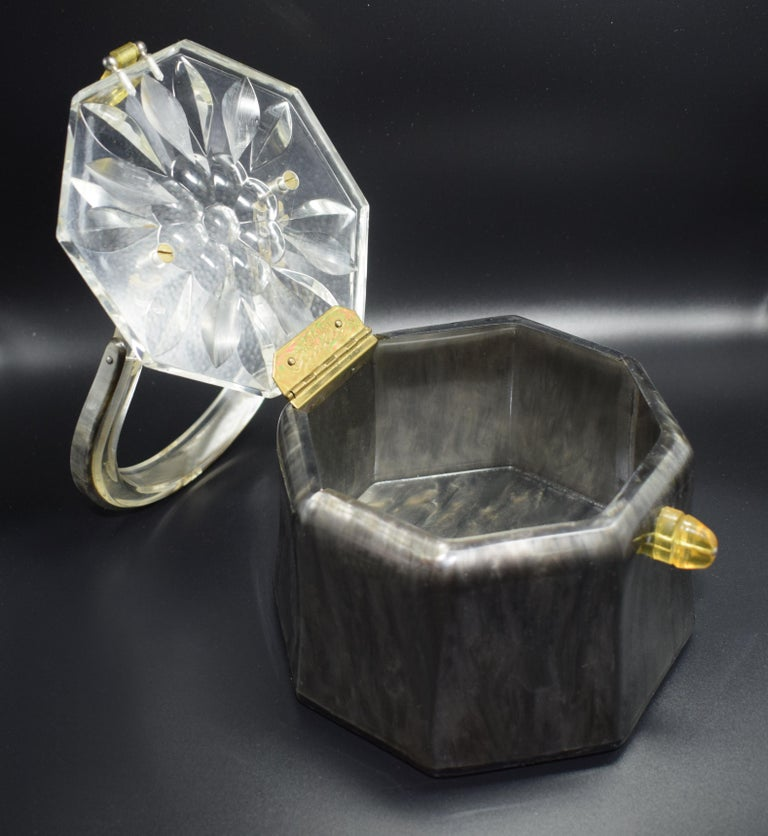 Fabulous 1950s Lucite box bag by Rialto of New York. Deeply carved clear Lucite lid with clear horse shoe shaped solid handle. The body of the bag is marbled grey with a yellow Lucite clasp. Signed on the inside brass hinge 'Original by Rialto'.