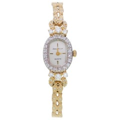 Ladies  14 Karat Gold and Diamond Andre Cheval Wristwatch