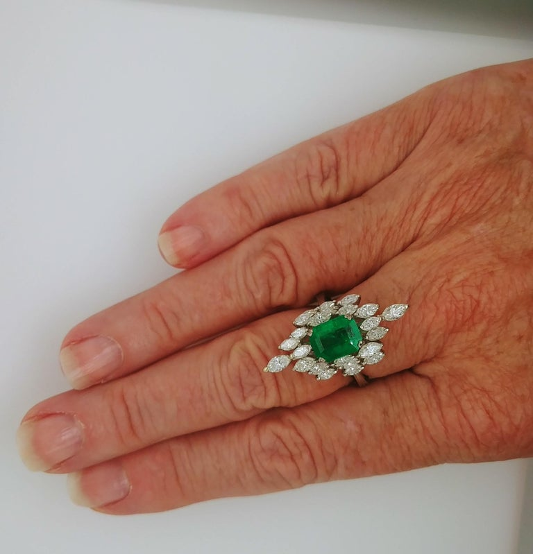Classy and Elegant Ladies Emerald and Diamond Cocktail Fashion Statement Ring is marquise shaped with a prong set deep green natural emerald cut Emerald measuring 9.15 x 7.14mm and weighing 2.36 carats in the center accentuated by 24 brilliant