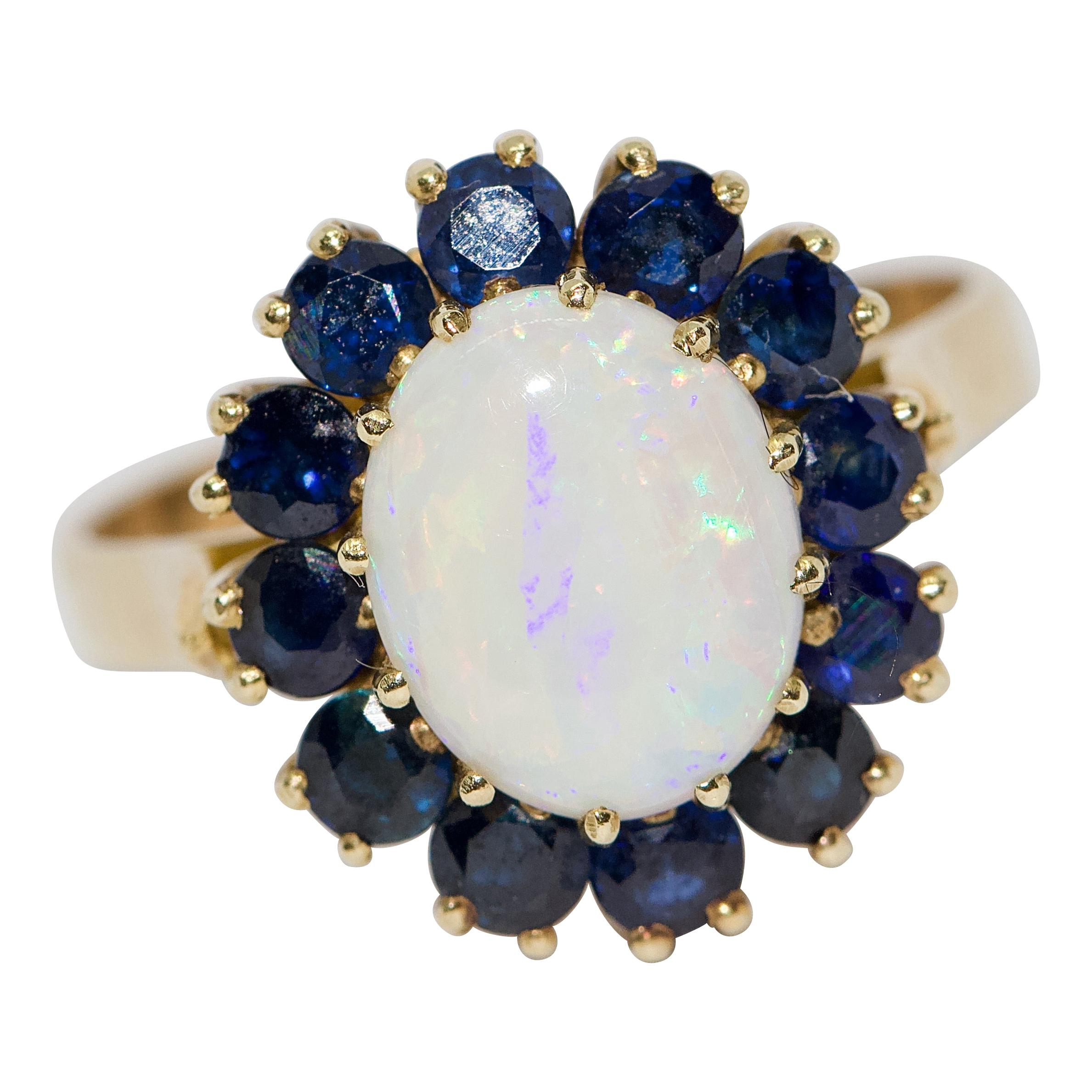 Ladies Gold Ring with Big Opal and Blue Sapphires