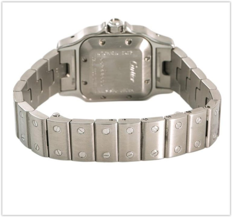 Silver-tone stainless steel case with a silver-tone stainless steel bracelet. Fixed silver-tone stainless steel bezel. Silver-tone dial with black hands and Roman numeral hour markers. Minute scale around the inner rim. Dial Type: Analog. Date