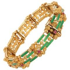 Ladies Nugget Gold Bracelet, 18 Karat, Set with Green Enamel and Rubies
