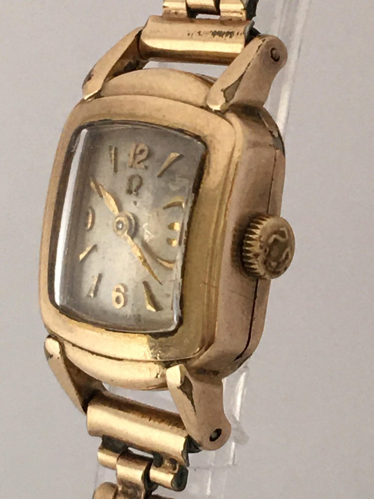 This beautiful and small gold plated vintage hand winding watch is working and it is ticking ticking and running well. Visible signs of wear and ageing with the silvered watch dial is a bit worn. some light tiny scratches on the glass and on the