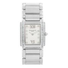 Ladies Patek Philippe Twenty-4 18 Karat White Gold and Diamond Watch 4910/20G