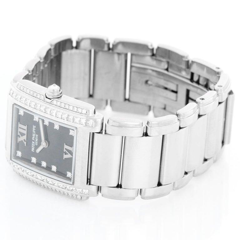 Ladies Patek Philippe Twenty-4 18k White Gold & Diamond Watch 4910/20G - Quartz. 18k white gold case with 2-row diamond bezel (25mm x 30mm). Black dial with diamond markers and Roman numerals at 12 & 6. 18k white gold Patek Philippe link bracelet;
