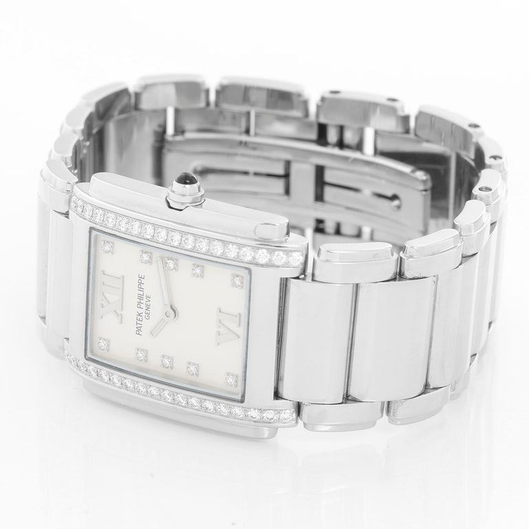 Ladies Patek Philippe Twenty-4 Watch Stainless Steel White Dial Watch 4910/10A - Quartz. Stainless steel case with diamond bezel (25mm x 30mm). White dial with diamond markers and Roman numerals at 12 & 6. Stainless steel Patek Philippe link