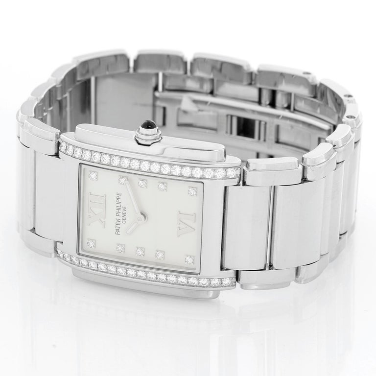 Ladies Patek Philippe Twenty-4 Watch Stainless Steel White Dial Watch 4910 - Quartz. Stainless steel case with diamond bezel (25mm x 30mm). White dial with diamond markers and Roman numerals at 12 & 6. Stainless steel Patek Philippe link bracelet;