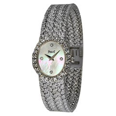 Ladies Piaget Petite Mother of Pearl Diamond Dial, White Gold Woven Band Watch