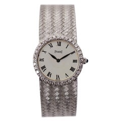 Ladies Piaget Watch with Roman Numeral White Dial and Diamond Bezel