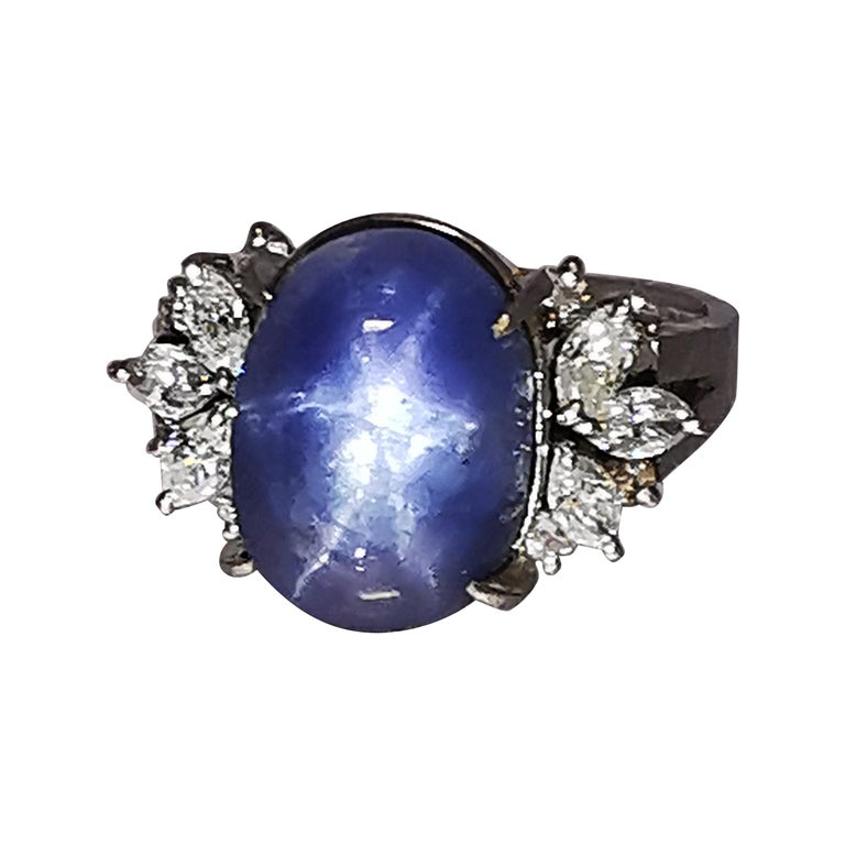 Ladies Platinum Cabochon Star Sapphire Ring with Diamonds For Sale